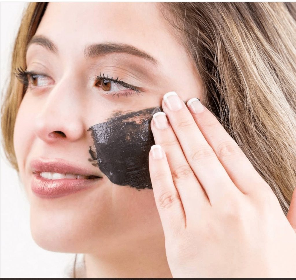 woman with black mask on healthy skin