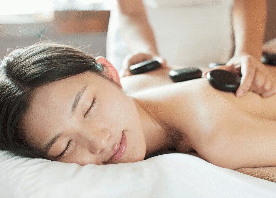 Got Text Neck? Relieve it with a Hot Stone Massage!